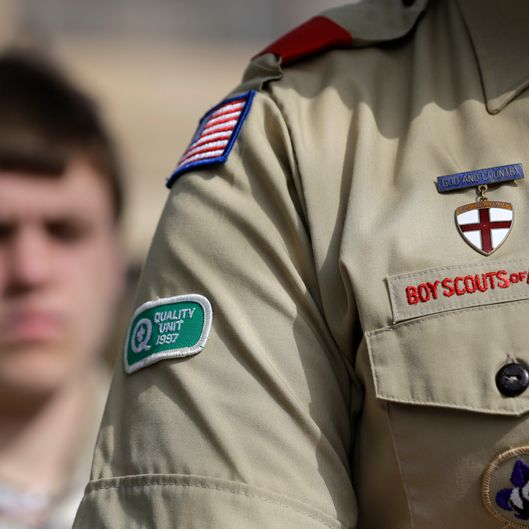 The Boy Scouts uniform fashioned with an Quality patch is on the arm of Brad Hankins, a campaign director for Scouts for Equality, as he responds to questions during a news conference in front of the Boy Scouts of America headquarters Monday, Feb. 4, 2013, in Dallas, Texas. Scouts and their families have delivered a petition to the Boy Scouts of America headquarters urging an end to a policy banning gay scouts and leaders from the organization. (AP Photo/Tony Gutierrez)