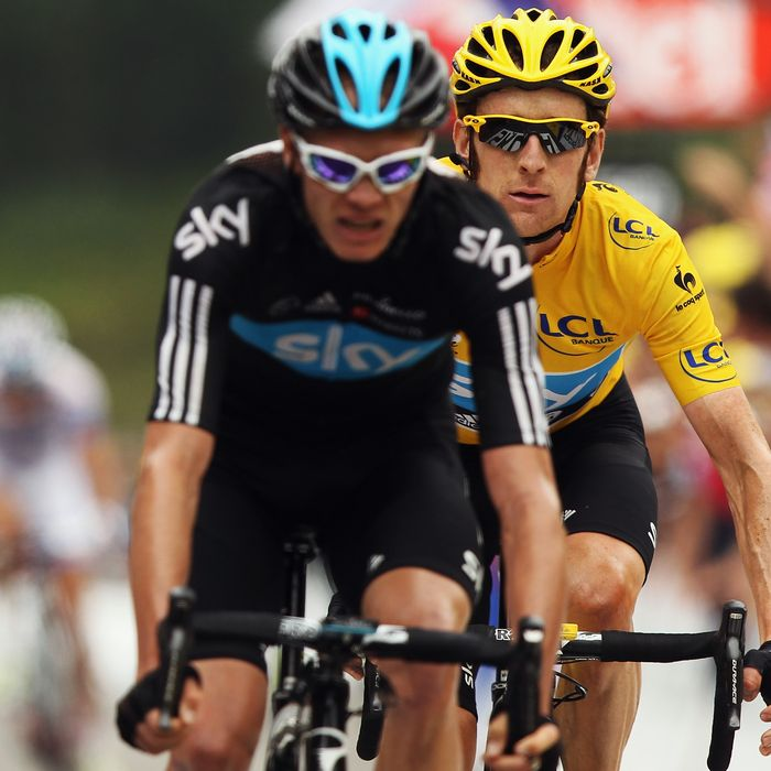 Chris Froome of Great Britain and SKY Procycling leads team mate and race leader Bradley Wiggins over the line on stage seventeen of the 2012 Tour de France from Bagneres-de-Luchon to Peyragudes on July 19, 2012 in Bagneres-de-Luchon, France.