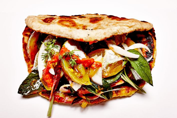 Mr. Curry's naan with curried green tomatoes, pickles, yogurt sauce, and herbs.