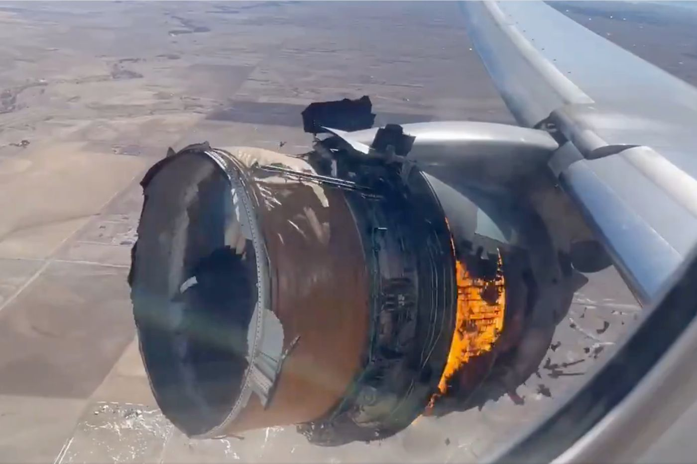 Terrifying viral video shows airplane engine on fire while still in the air
