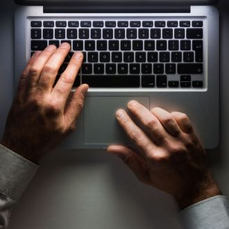 Laptop computer with man's hands