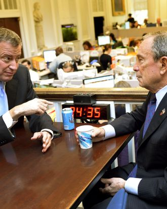 New York City Mayor Michael Bloomberg meets with Mayor-Elect Bill de Blasio on November 6, 2013 at City Hall, the morning after De Blasio was elected New York Citys first Democratic mayor in two decades. De Blasio won a stunning landslide victory of 73.3 percent of votes cast compared to 24.3 percent for his Republican rival Joe Lhota, according to results from 99 percent of polling stations. But of the 4.6 million registered voters in New York only 1.02 million actually cast their vote, based on those results. AFP PHOTO / TIMOTHY CLARY (Photo credit should read TIMOTHY CLARY/AFP/Getty Images)