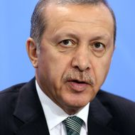 BERLIN, GERMANY - FEBRUARY 04:  Turkish Prime Minister Recep Tayyip Erdogan speaks to the media following talks with German Chancellor Angela Merkel at the German federal Chancellery on February 4, 2013 in Berlin, Germany. The two leaders discussed issues including bilateral relations, the situation in Syria and the Turkish economy.  (Photo by Adam Berry/Getty Images)