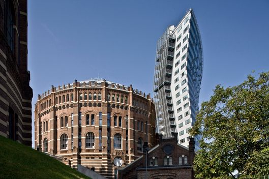 Converted Gasometer B, residential conversion of Deconstructivism architecture rebuilt (1999-2001) by Coop Himmelb, Gasometers from 1896 to 1899 in the Simmering district of Vienna, Austria
