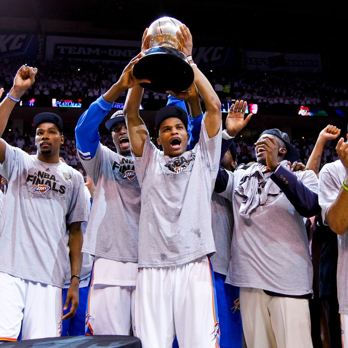 Oklahoma City Thunder players, from left, Kevin Durant #35, Serge Ibaka #9 and Russell Westbrook #0 stand with the Western Conference Finals Champions trophy following their team's victory against the San Antonio Spurs in Game Six of the Western Conference Finals during the 2012 NBA Playoffs on June 6, 2012 at the Chesapeake Energy Arena in Oklahoma City, Oklahoma.