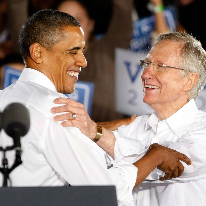 LAS VEGAS - OCTOBER 22: U.S. President Barack Obama (L) and U.S. Senate Majority Leader Harry Reid (D-NV) appear at a campaign rally at Orr Middle School Park October 22, 2010 in Las Vegas, Nevada. Reid, who is seeking his fifth term, is in a tight race with Republican challenger Sharron Angle. (Photo by Ethan Miller/Getty Images) *** Local Caption *** Barack Obama;Harry Reid