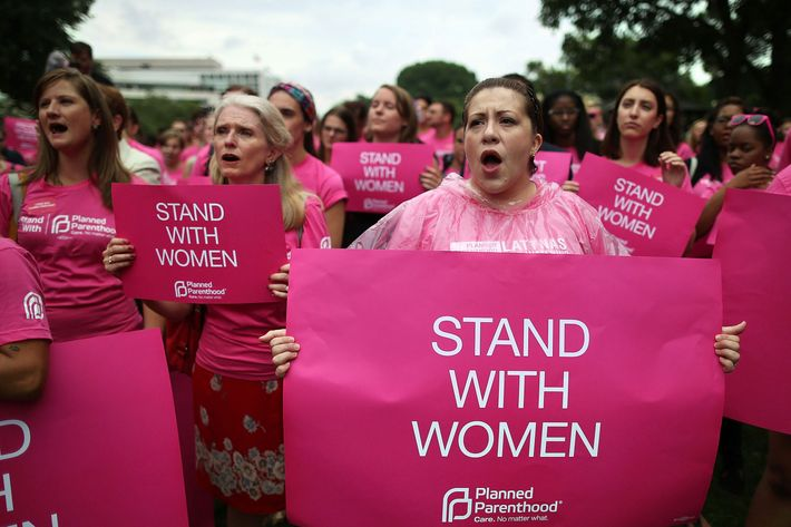 Women hold up signs during a women's pro-choice rally on Capitol Hill, July 11, 2013 in Washington, D.C. The rally was hosted by Planned Parenthood Federation of America to urge Congress against passing any legislation to limit access to safe and legal abortion.