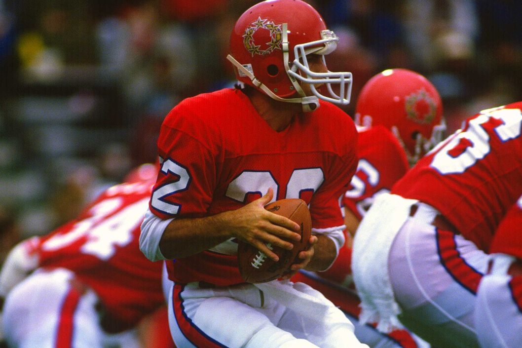 EAST RUTHERFORD, NJ - CIRCA 1985:  Quarterback Doug Flutie #22 of the New Jersey Generals drops back to pass against the Birmingham Stallions during an USFL football game circa 1985 at Giants Stadium in East Rutherford, New Jersey. Flutie played for the Generals in 1985.. (Photo by Focus on Sport/Getty Images) *** Local Caption *** Doug Flutie