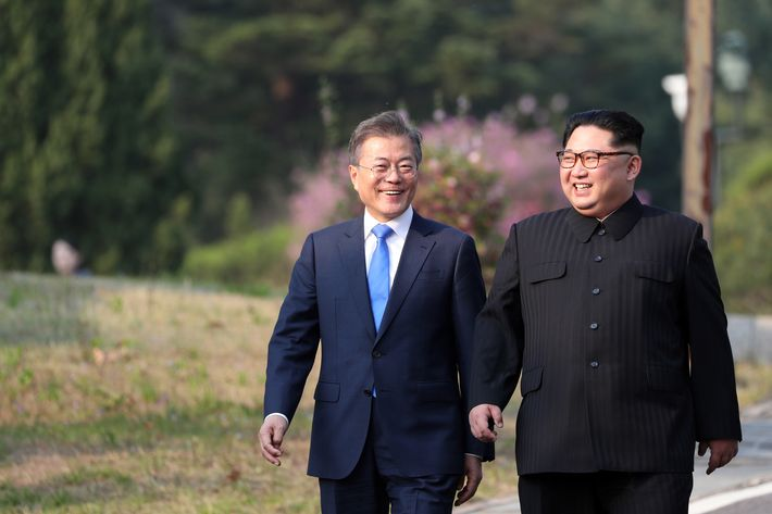 North Korea's leader Kim Jong Un (R) and South Korea's President Moon Jae-in (L) walk together after a tree-planting ceremony at the truce village of Panmunjom on April 27, 2018. - The leaders of the two Koreas held a landmark summit on April 27 after a highly symbolic handshake over the Military Demarcation Line that divides their countries, with the North's Kim Jong Un declaring they were at the 'threshold of a new history'.