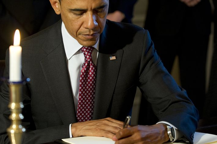 US President Barack Obama signs a book of condolences at the Norwegian Ambassador's residence in Washington, DC, July 26, 2011. Obama visited the residence of the Norwegian ambassador on Tuesday to personally offer his condolences after 76 people died in twin attacks.    AFP PHOTO/Jim WATSON (Photo credit should read JIM WATSON/AFP/Getty Images)