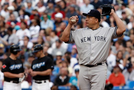 TORONTO, CANADA - JULY 14: Bartolo Colon #40 of the New York Yankees reacts to a 8 run first inning against the Toronto Blue Jays during MLB action at The Rogers Centre July 14, 2011 in Toronto, Ontario, Canada. (Photo by Abelimages/Getty Images)