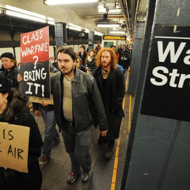 Demonstrators with 'Occupy Wall Street' march through a subway station at Wall Street on their way towards the New York Stcok Exchange as they mark the two month anniversary of the protest November 17, 2011 in New York. AFP PHOTO/Stan HONDA (Photo credit should read STAN HONDA/AFP/Getty Images)