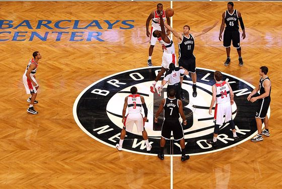 Brook Lopez #11 of the Brooklyn Nets takes the opening tip off against Emeka Okafor #50 of the Washington Wizards during the a preseason game at the Barclays Center on October 15, 2012 in the Brooklyn borough of New York City.