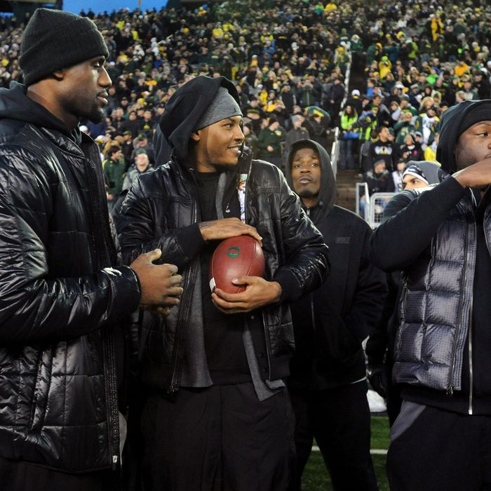 EUGENE, OR - NOVEMBER 19: (L to R) LeBron James, Carmelo Anthony and Dwyane Wade play around on the sidelines before the game between the Oregon Ducks and the USC Trojans at Autzen Stadium on November 19, 2011 in Eugene, Oregon. (Photo by Steve Dykes/Getty Images)