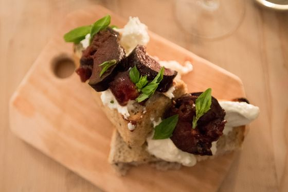Country loaf with burrata, pickled eggplant and oregano.