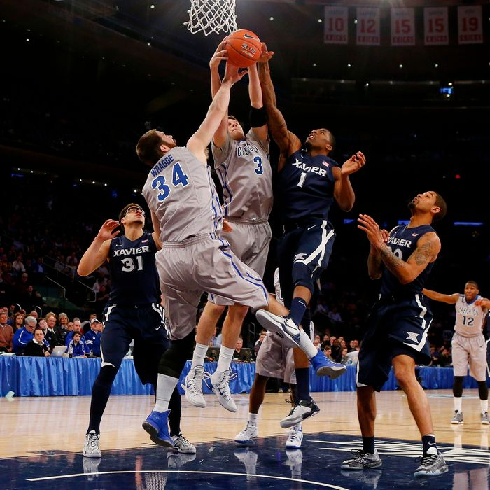 NEW YORK, NY - MARCH 14: Jalen Reynolds #1 of the Xavier Musketeers vies for a rebound with Doug McDermott #3 and Ethan Wragge #34 of the Creighton Bluejays in the first half during the Semifinals of the 2014 Men's Big East Basketball Tournament at Madison Square Garden on March 14, 2014 in New York City. (Photo by Jim McIsaac/Getty Images)