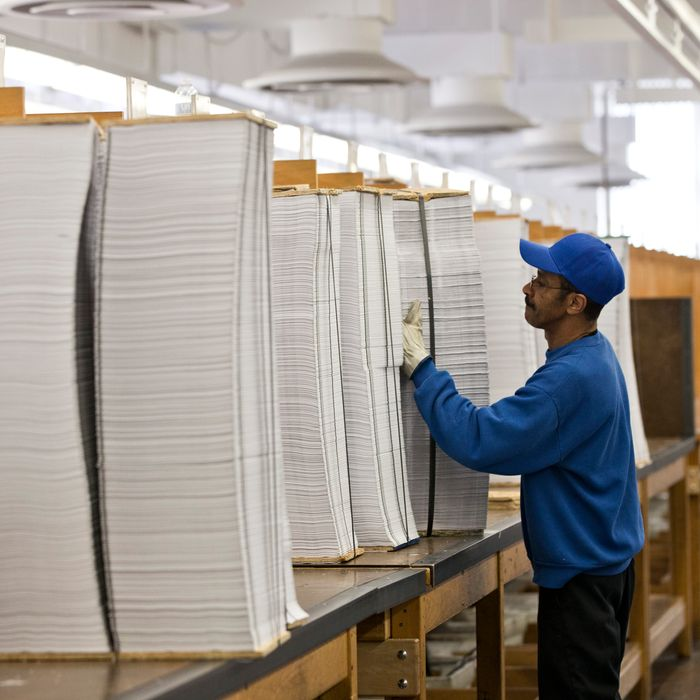 Printed copies of President Barack Obama's proposed budget plan for fiscal year 2014 are prepared for binding at the U.S. Government Printing Office in Washington, Monday, April 8, 2013. (AP Photo/J. Scott Applewhite)