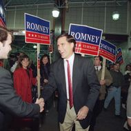 Massachusetts Republican candidate for the U.S. Senate Mitt Romney shakes the hand of a commuter while campaigning at North Station in Boston, Nov. 7, 1994.