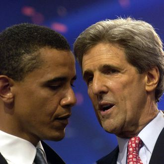 Democratic presidential nominee John Kerry talks with U.S. Senate candidate Barack Obama from Illinois onstage July 29, 2004 during the Democratic National Convention at the FleetCenter in Boston, Massachusetts. Kerry accepted his party's presidential nomination during his speech this evening bringing the convention to a close.