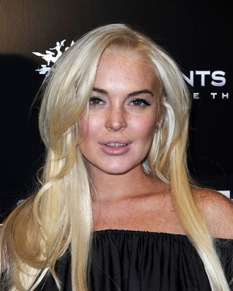LOS ANGELES, CA - OCTOBER 12: Actress Lindsay Lohan attends the Premiere Of THQ's
