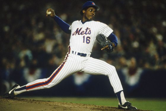 FLUSHING, NY - OCTOBER 19: Pitcher Dwight Gooden #16 of the New York Mets rears backbefore firing a pitch during Game Two of the World Series against the Boston Red Sox at Shea Stadium on October 19, 1986 in Flushing, New York.  The Red Sox defeated the Mets 9-3. (Photo by Focus on Sport/Getty Images)
