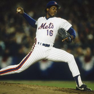 FLUSHING, NY - OCTOBER 19: Pitcher Dwight Gooden #16 of the New York Mets rears back before firing a pitch during Game Two of the World Series against the Boston Red Sox at Shea Stadium on October 19, 1986 in Flushing, New York. The Red Sox defeated the Mets 9-3. (Photo by Focus on Sport/Getty Images)