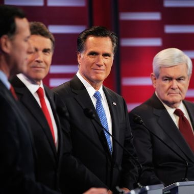 Mitt Romney (C) former speaker of the House Newt Gingrich (R) during the ABC News GOP Presidential debate on the campus of Drake University on December 10, 2011 in Des Moines, Iowa.