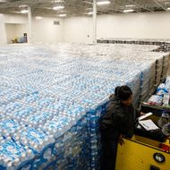 Pallets of bottled water are seen ready for distribution in a warehouse January 21, 2016 in Flint, Michigan. The warehouse is the emergency water supply for Flint residents affected by lead-contaminated water.