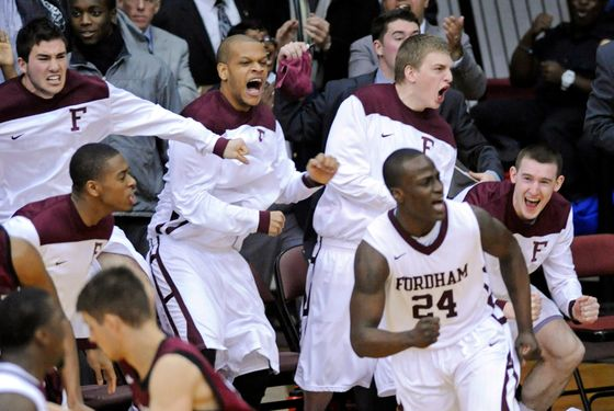Fordham players celebrate after Bryan Smith (24) hit a 3-point shot during the second half of an NCAA college basketball game against Harvard on Tuesday, Jan. 3, 2012, in New York. Fordham defeated Harvard 60-54. (AP Photo/Bill Kostroun)