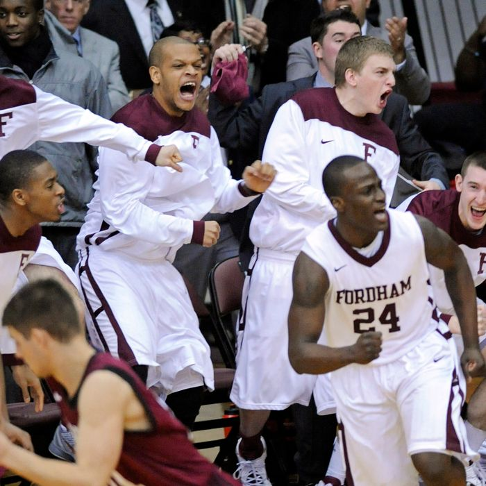 Fordham players celebrate after Bryan Smith (24) hit a 3-point shot during the second half of an NCAA college basketball game against Harvard on Tuesday, Jan. 3, 2012.