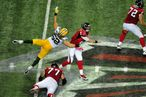 ATLANTA, GA - OCTOBER 9: Matt Ryan #2 of the Atlanta Falcons passes despite pressure by Clay Matthews #52 the Green Bay Packers at the Georgia Dome on October 9, 2011 in Atlanta, Georgia. (Photo by Scott Cunningham/Getty Images)