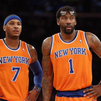 Carmelo Anthony #7 and Amar'e Stoudemire #1 of the New York Knicks wait for play to resume during the second quarter against the Boston Celtics at Madison Square Garden on December 8, 2013 in New York City.
