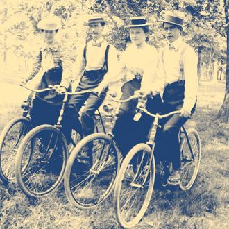 A quartet poses on their bikes, ca. 1895.