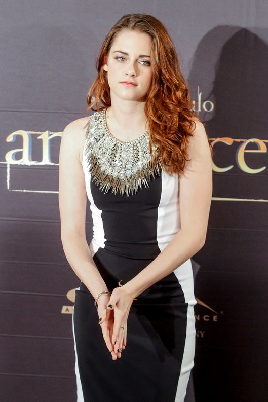 Kristen Stewart, Taylor Lautner and Robert Pattinson attend the 'Twilight Breaking Dawn Part 2' photocall at the Villamagna Hotel.
