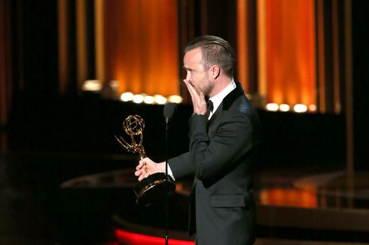 LOS ANGELES, CA - AUGUST 25:  66th ANNUAL PRIMETIME EMMY AWARDS -- Pictured: Actor Aaron Paul accepts the Outstanding Supporting Actor in a Drama Series award for 'Breaking Bad' on stage during the 66th Annual Primetime Emmy Awards held at the Nokia Theater on August 25, 2014.  (Photo by Mark Davis/NBC/NBC via Getty Images)