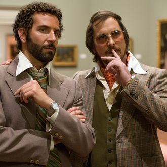 Richie Dimaso (Bradley Cooper, left) and Irving Rosenfeld (Christian Bale) talk in a gallery at the Frick Museum in Columbia Pictures' AMERICAN HUSTLE.