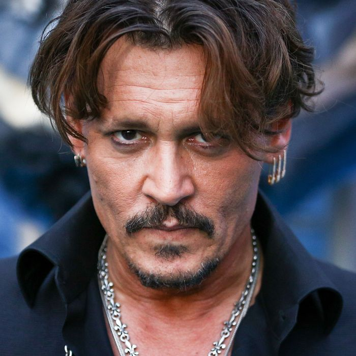 Johnny Depp Reportedly Spent $7000 on a Kardashian Kouch