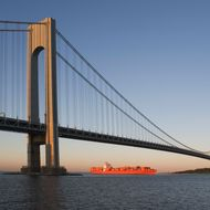 USA, New York State, New York City, Brooklyn, Container Ship under Verrazano-Narrows Bridge