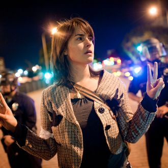 A member of Occupy LA protests on the street in front of City Hall in downtown on November 28, 2011.