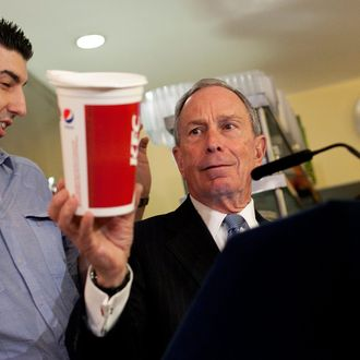 New York City Mayor Michael Bloomberg holds a large cup as he speaks to the media about the health impacts of sugar at Lucky's restaurant, which voluntarily adopted the large sugary drink ban, March 12, 2013 in New York City. A state judge on Monday blocked Bloomberg's ban on oversized sugary drinks but the Mayor plans to appeal the decision.