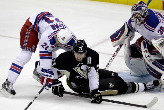 Pittsburgh Penguins' Evgeni Malkin (71) collides with New York Rangers' Derek Stepan (21) in front of goalie Henrik Lundqvist during the first period of an NHL hockey game in Pittsburgh, Tuesday, Feb. 21, 2012. (AP Photo/Gene J. Puskar)