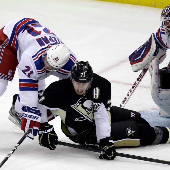 Pittsburgh Penguins' Evgeni Malkin (71) collides with New York Rangers' Derek Stepan (21) in front of goalie Henrik Lundqvist during the first period of an NHL hockey game in Pittsburgh, Tuesday, Feb. 21, 2012.
