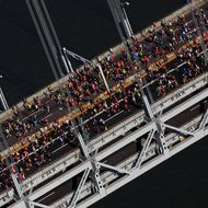 NEW YORK - NOVEMBER 06:  Runners cross the Verrazano-Narrows Bridge towards Brooklyn at the start of the ING New York City Marathon as seen from the air on November 6, 2011 in New York City.  (Photo by Chris Trotman/Getty Images)