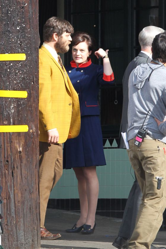 "Los Feliz, CA - ""Mad Men"" stars Elisabeth Moss and Aaron Staton film scenes for their hit show at Little Dom's restaurant in Los Angeles, dressed in retro attire."