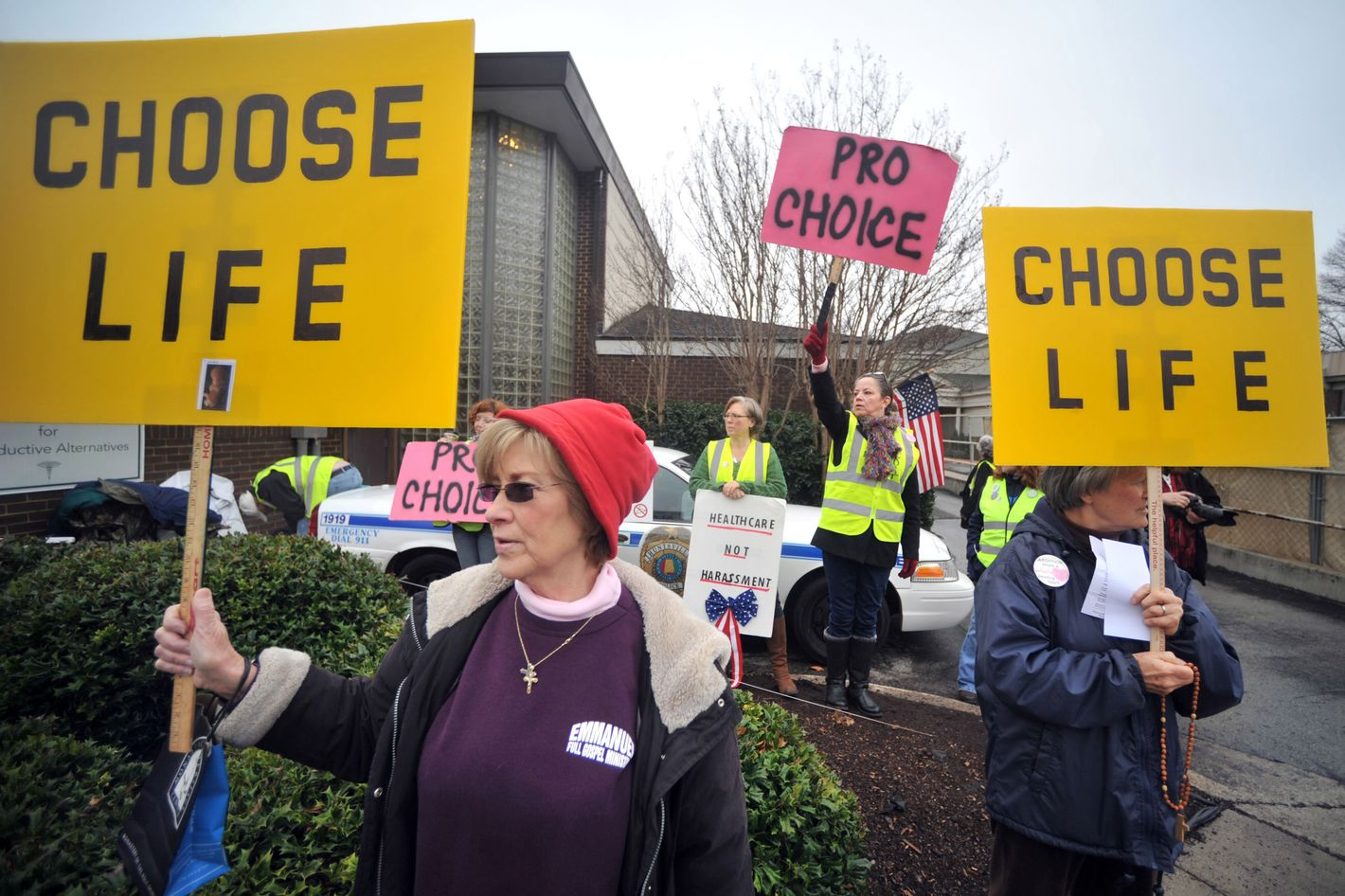 "People supporting and opposing abortion demonstrate outside of the Alabama Women's Center for Reproductive Alternatives in Huntsville, Ala., Saturday, Feb. 23, 2013, during a ""40 Days of Life Prayer Vigil."" (AP Photo/AL.com, Sarah Cole) MAGS OUT"