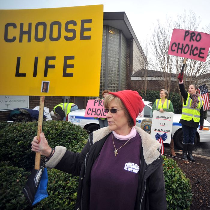 People supporting and opposing abortion demonstrate outside of the Alabama Women's Center for Reproductive Alternatives in Huntsville, Ala., Saturday, Feb. 23, 2013, during a