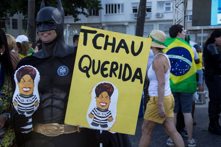 "Many protesters held signs reading ""Tchau Querida,"" or ""bye bye dear."""