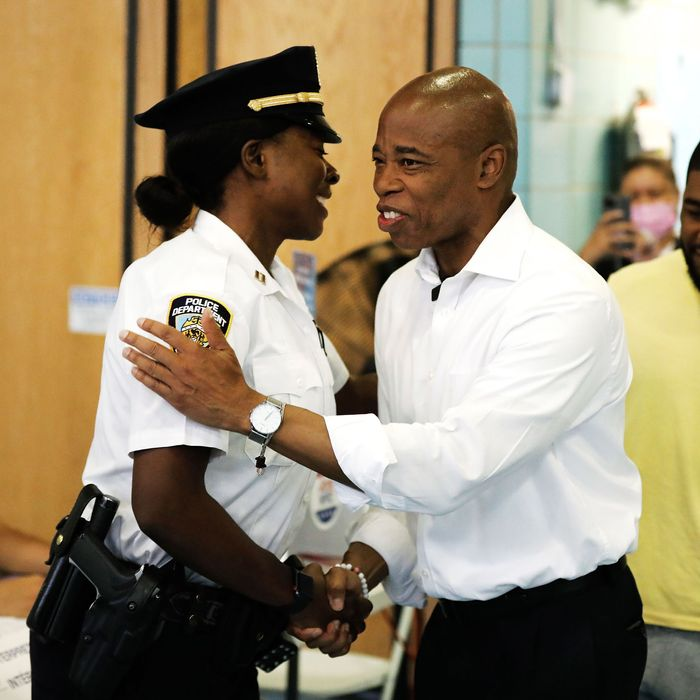 Brooklyn borough president and New York mayoral candidate Eric Adams daps up a cop.