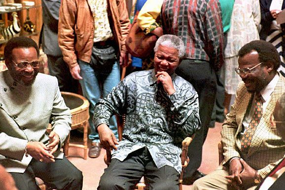 President Nelson Mandela (center) flanked by Zulu King Zwelithin (left) and Inkatha Freedom Party Leader Mangosuthu Buthelezi gather at Hluhluwe Game Reserve in Northern Nata.