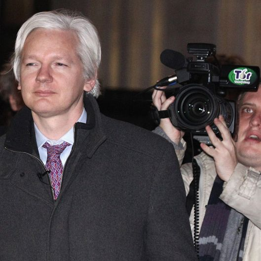 Julian Assange (L), the founder of the WikiLeaks whistle-blowing website, leaves the Supreme Court on February 02, 2012 in London, England.